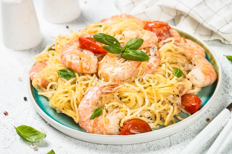 Pasta seafood with shrimp on white table. royalty free stock photography