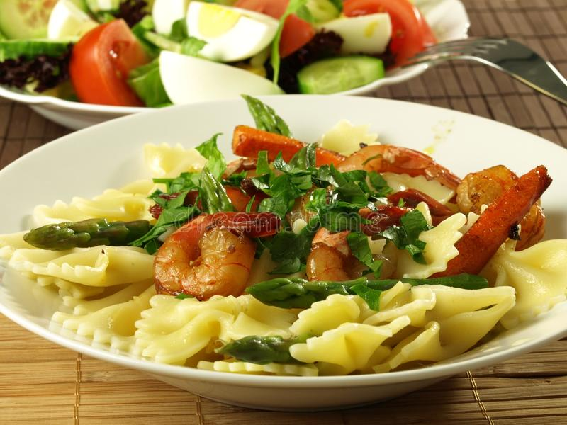 Pasta and shrimps stock image