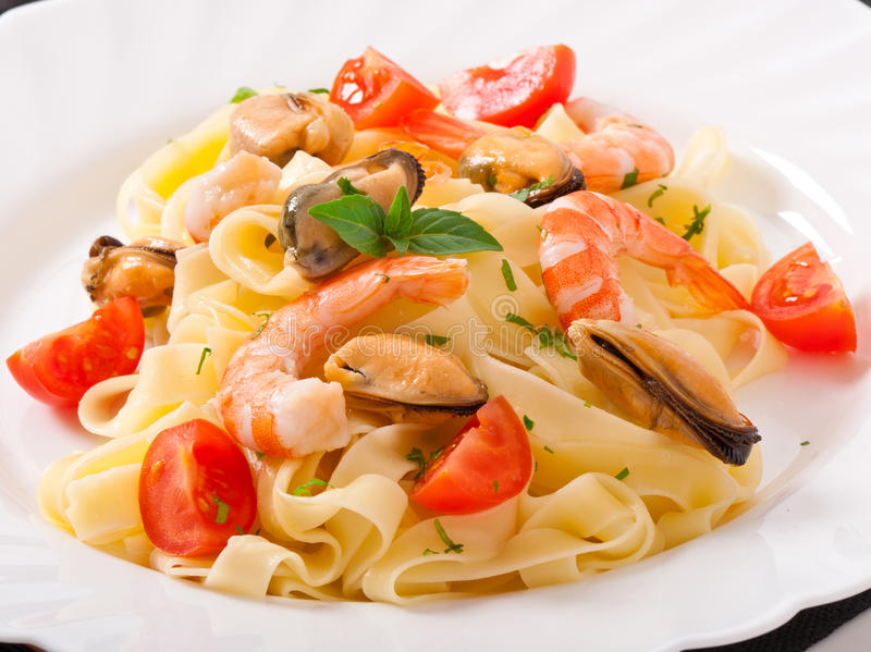 Pasta with shrimps, mussels royalty free stock image