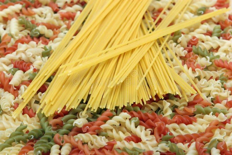 Pasta and spaghetti. Colorful dry pasta and spaghetti stock image