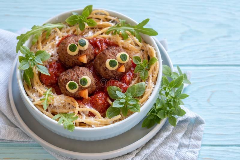 Pasta spaghetti with funny meatballs for kids. Birds in nests stock photo