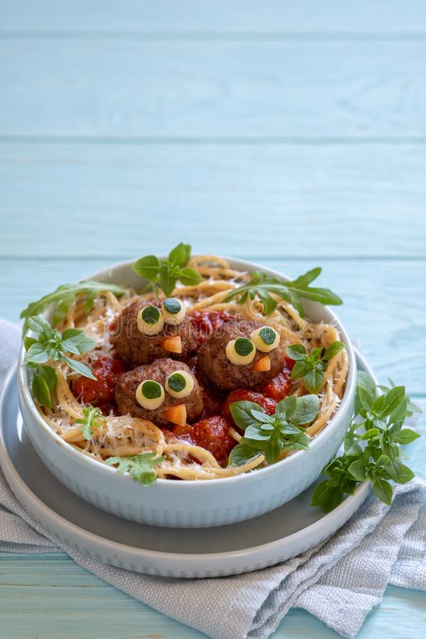 Pasta spaghetti with funny meatballs for kids. Birds in nests stock images
