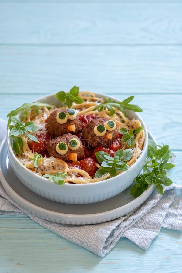 Pasta spaghetti with funny meatballs for kids. Birds in nests royalty free stock photo