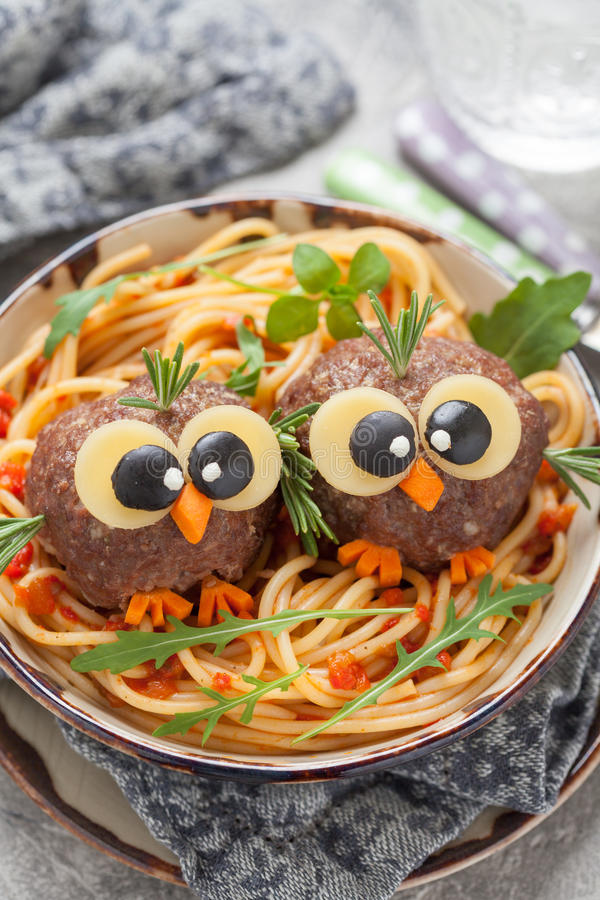Pasta spaghetti with funny meatballs for kids. Birds in nests royalty free stock photography