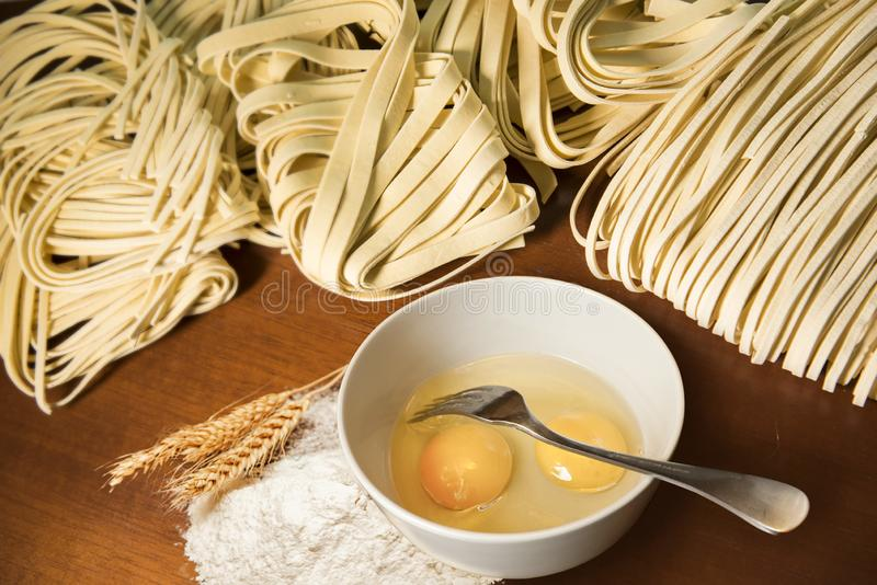 Pasta spaghetti noodles eggs and flour stock photo