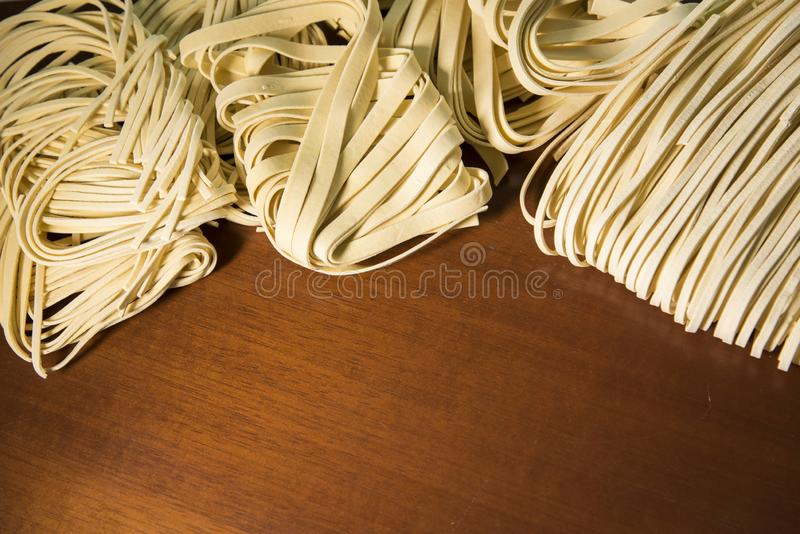 Pasta spaghetti noodles eggs and flour royalty free stock image