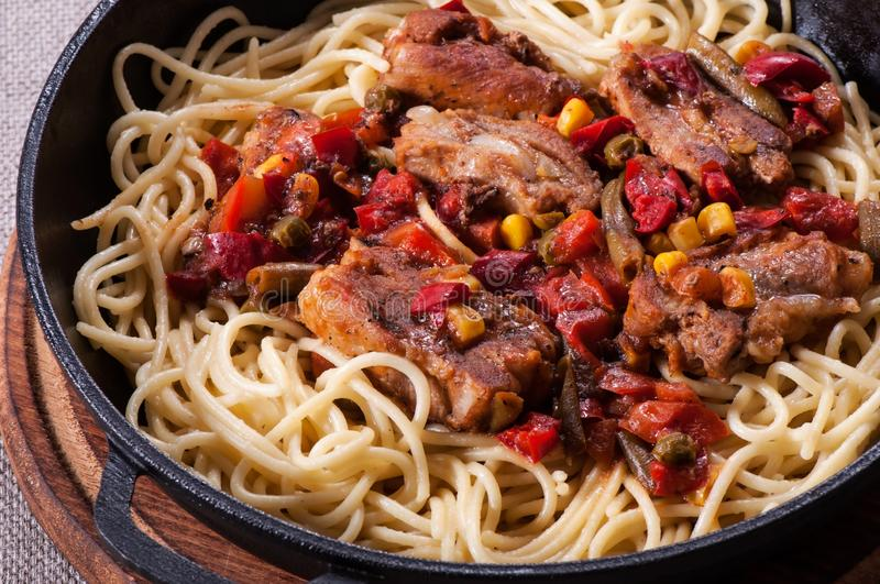 Pasta spaghetti in tomato sauce and rib meat royalty free stock photography