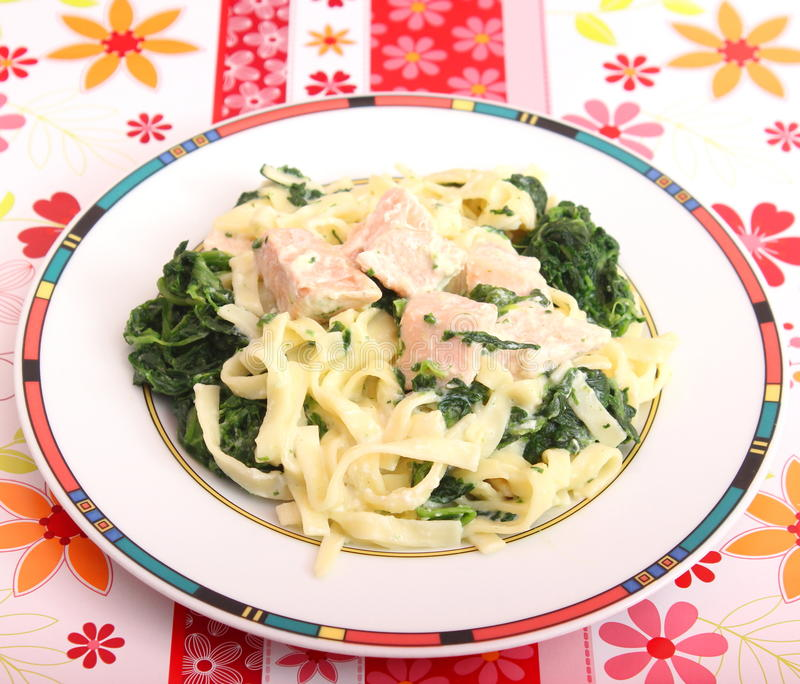 Pasta With Spinach And Salmon Fish Stock Photo