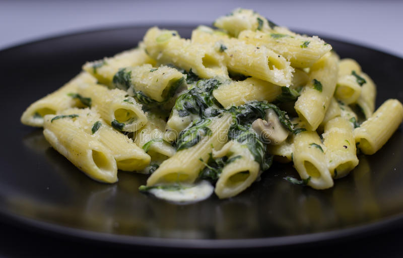 Pasta with spinach royalty free stock photography