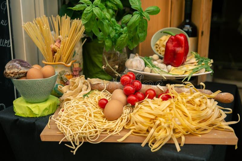 Pasta - Stylish decoration of basic ingredients of Italian food royalty free stock images