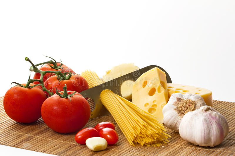 Pasta, tomato and garlic. Composition of pasta, tomato and garlic royalty free stock photo