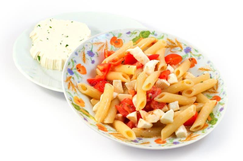 Pasta with tomato and mozzarella royalty free stock image