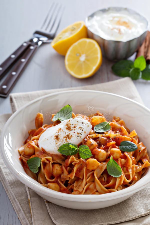 Pasta with tomato sauce and chickpeas royalty free stock photo