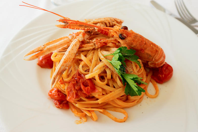 Pasta with tomato sauce and langoustines stock photo