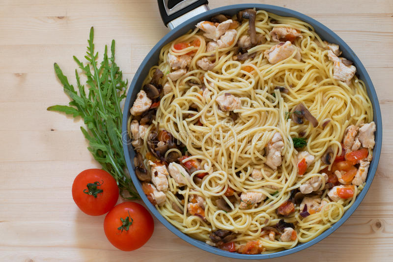 Pasta and tomato. Pasta, spaghetti, penne with tomatoes and arugula royalty free stock image