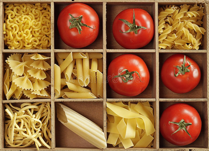 Pasta and tomatoes stock photos