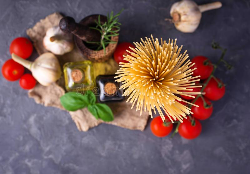 Pasta, tomatoes, olive oil and vinegar royalty free stock photo