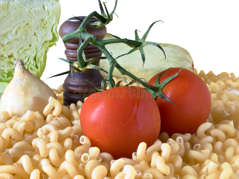 Pasta and vegetables. Isolated a white background. The photo has a clipping path for your convenience stock photography