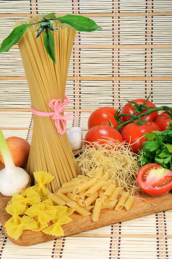 Pasta and vegetables stock images