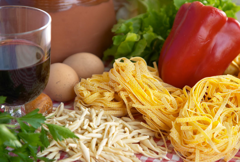 Pasta, vegetables, egg, wine royalty free stock photo