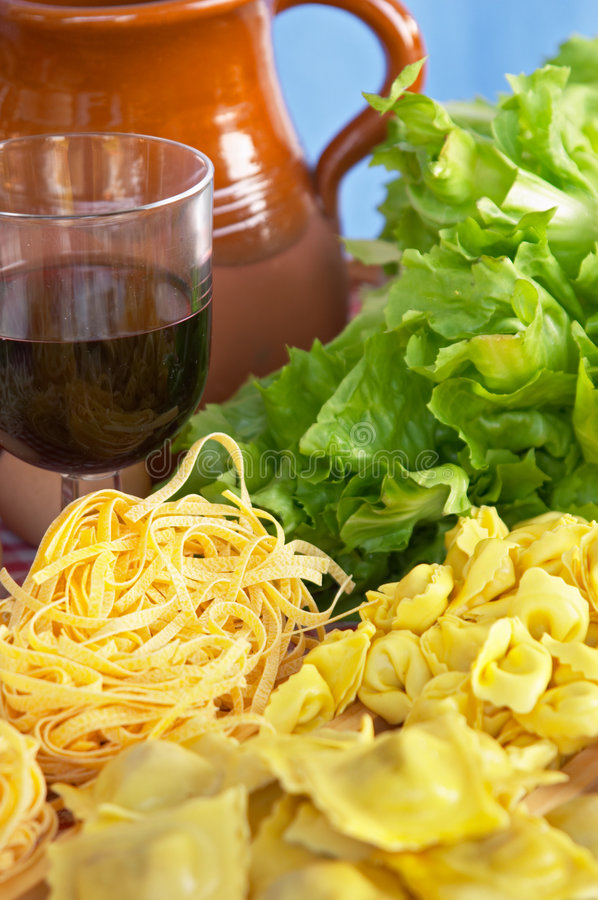 Pasta, vegetables, egg, wine royalty free stock images