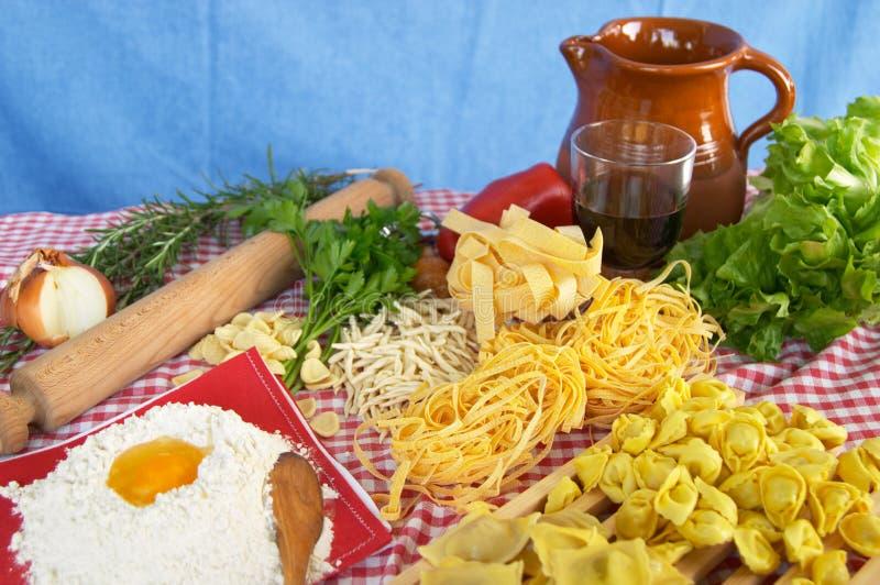 Pasta, vegetables, egg, wine stock photography