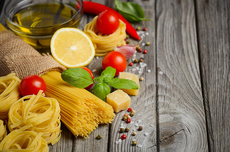 Pasta, vegetables, herbs and spices for Italian food stock image