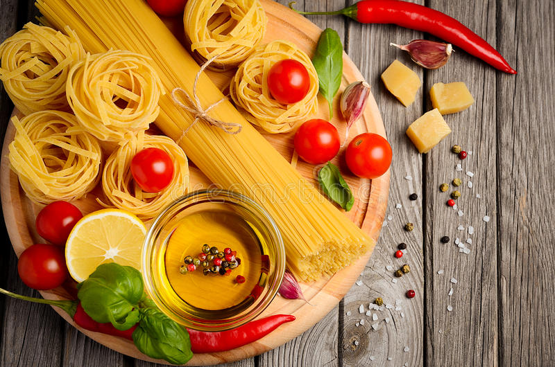 Pasta, vegetables, herbs and spices for Italian food royalty free stock photos