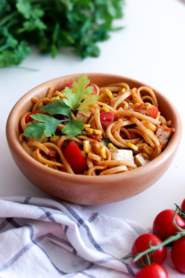 Pasta with zacusca, corn, tofu and tomato stock photo