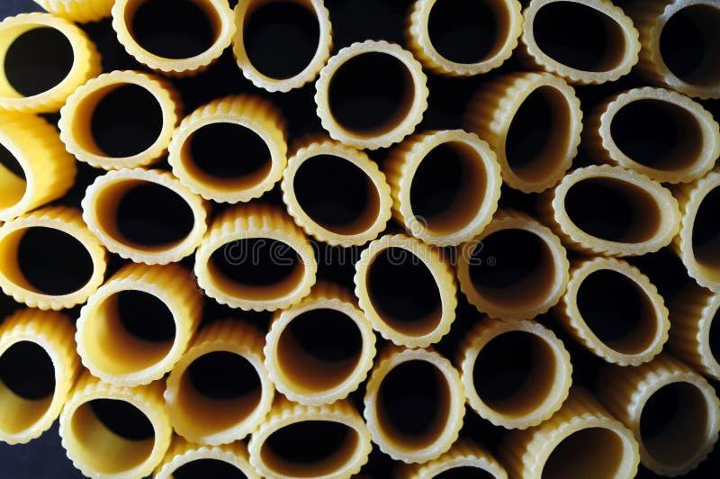 Pastamezzemanichebakgrund arkivfoto