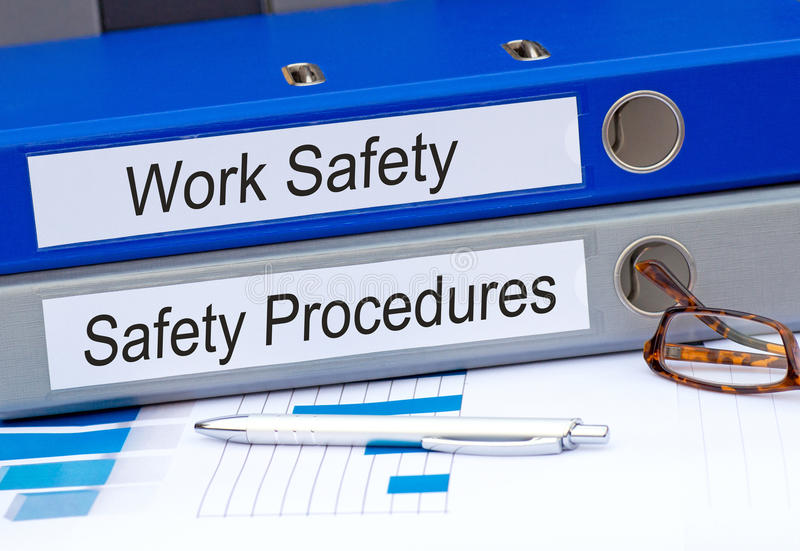 Pastas da segurança do trabalho e dos procedimentos de segurança imagem de stock