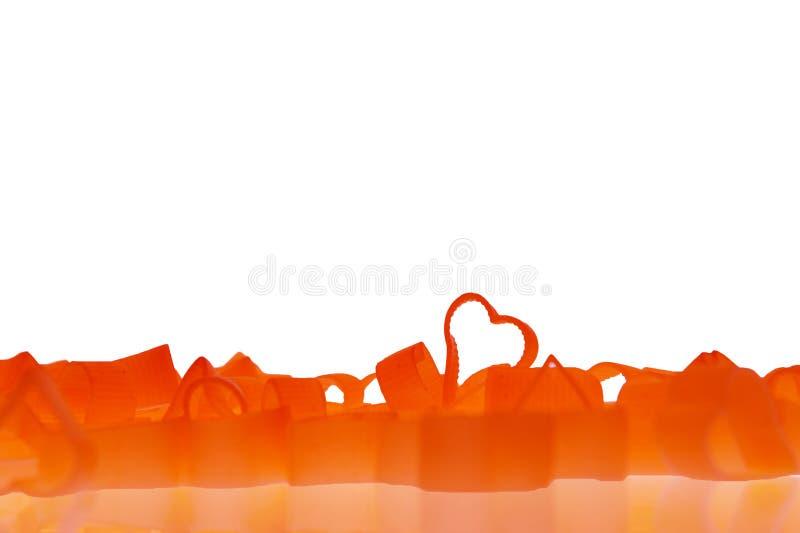 Pastas en forma del corazón en el fondo blanco fotografía de archivo libre de regalías