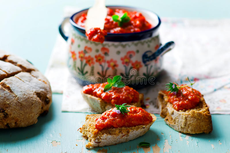 Paste from baked sweet pepper. On slices of homemade bread with bran. healthy food. selective focus stock photos