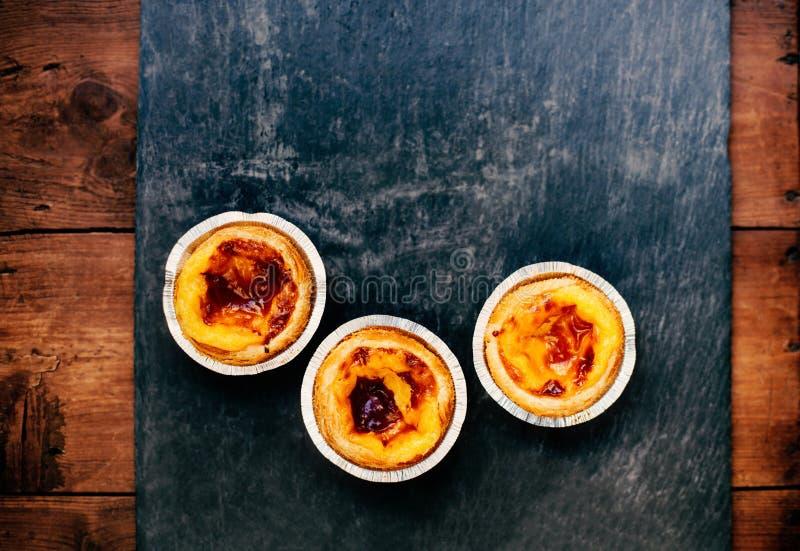 Pasteis De Nata typowi Portugalscy jajeczni tarta ciasta, jajko smoła -/ zdjęcie stock