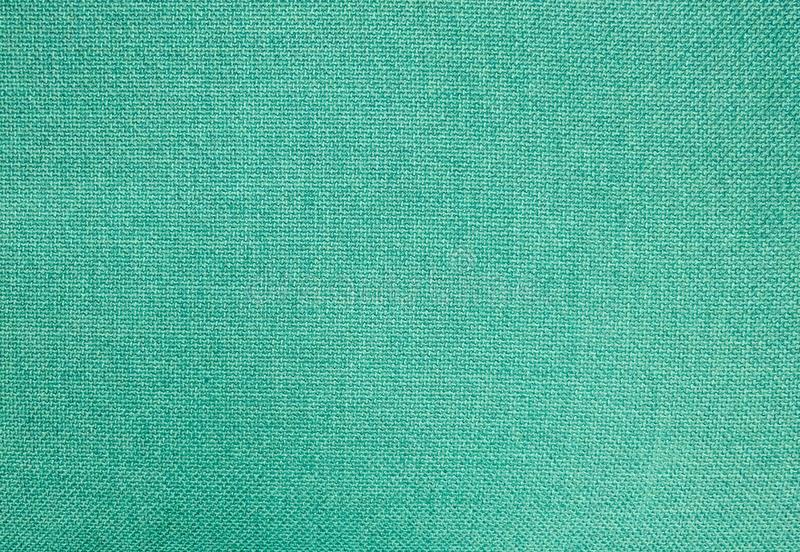 Pastel Background of Green Cotton Textile Texture royalty free stock photo