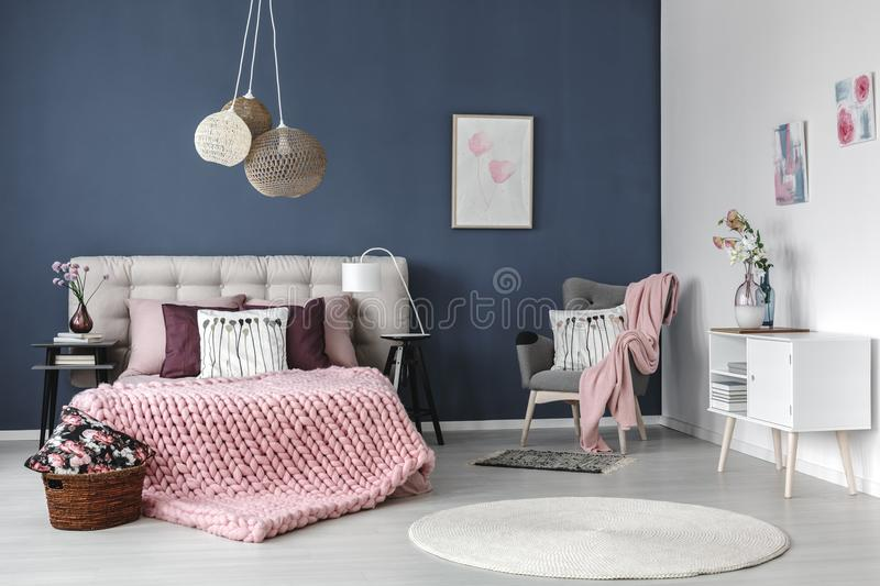 Pastel bedroom with designed lamp stock photo