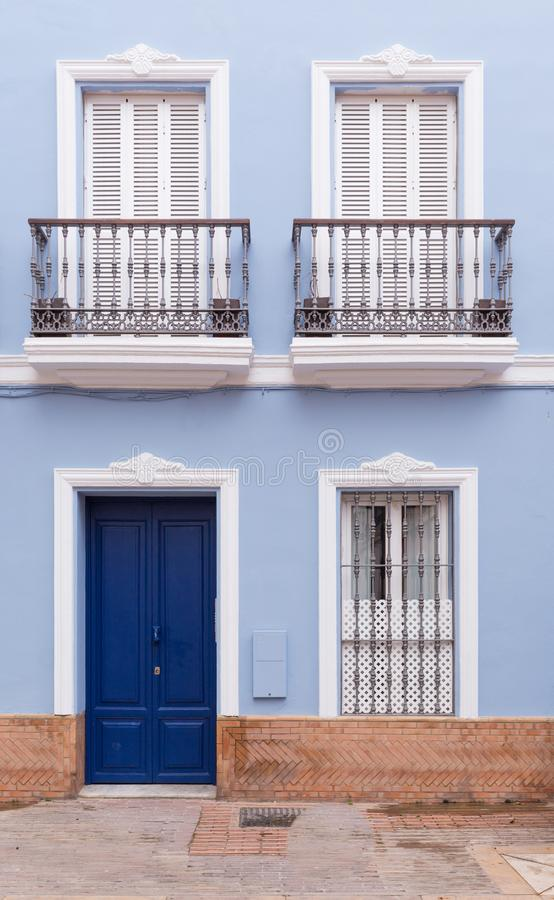 Pastel blue tenement that with stylish windows and doors royalty free stock photo