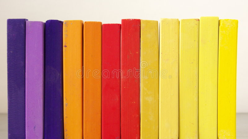 Pastel Chalk. A row of pastel chalk in front of bright background royalty free stock photo