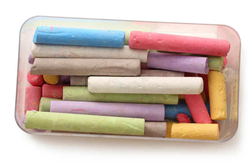 Pastel chalks in box. On white stock photography