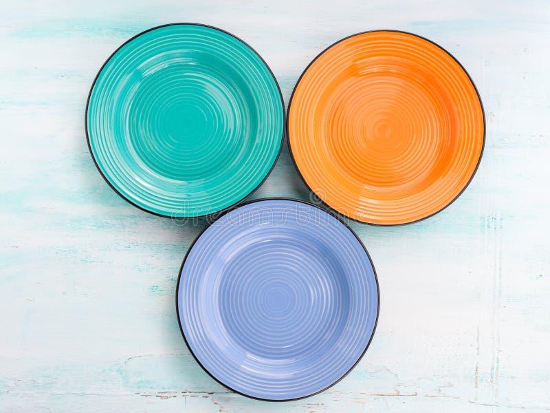 Pastel Color ceramic plate dish top view background. Pastel Color ceramic turquoise, orange, blue plate dish top view background stock photos