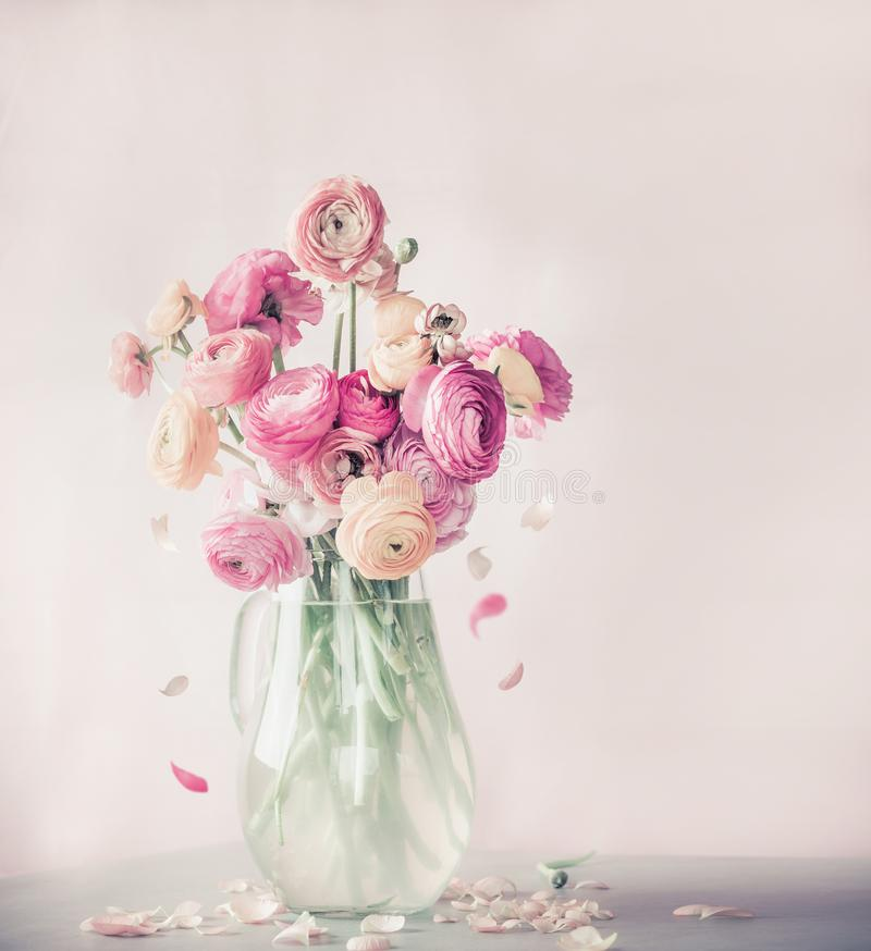 Pastel Color Ranunculus Flowers Bouquet With Falling Petals In Glass