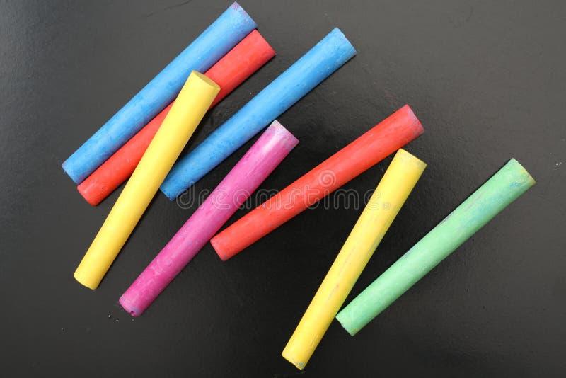 Pastel colored chalk sticks royalty free stock photo