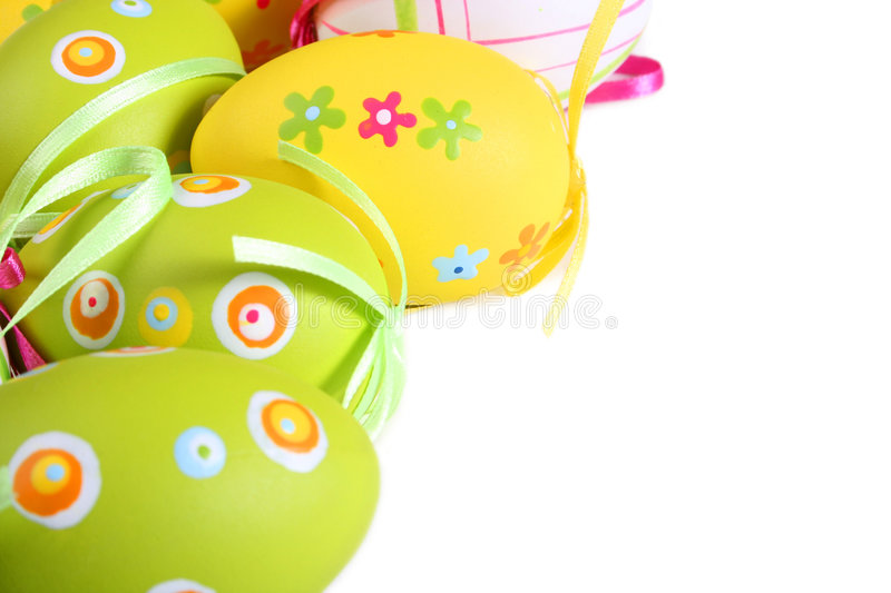 Pastel and colored Easter eggs. Isolated in white