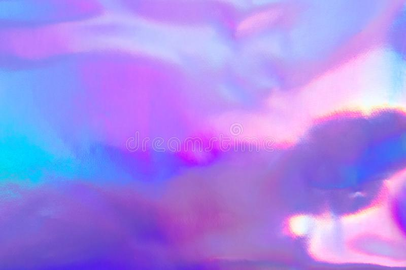 Pastel colored holographic background. Abstract trendy holographic background in 80s style. Blurred texture in violet, pink and mint colors with scratches and stock photos