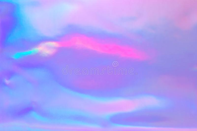 Pastel colored holographic background. Abstract trendy holographic background in 80s style. Blurred texture in violet, pink and mint colors with scratches and royalty free illustration