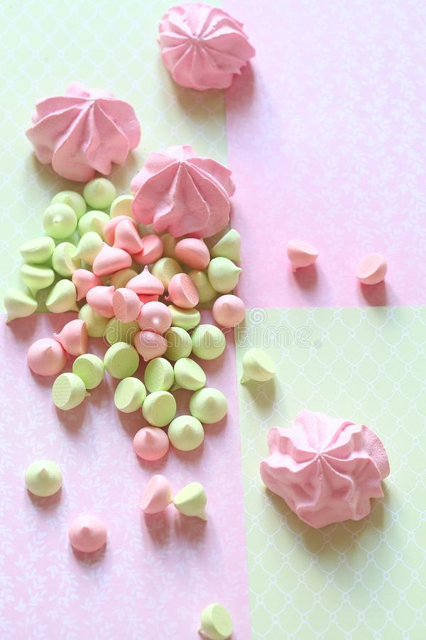 Pastel colored Meringue Cookies. In light background royalty free stock photography
