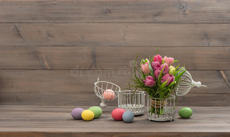 Pastel colored tulip flowers and easter eggs royalty free stock photos