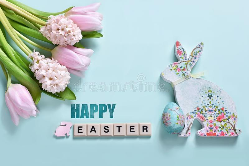Easter background with bunch of spring flowers and bunny royalty free stock image