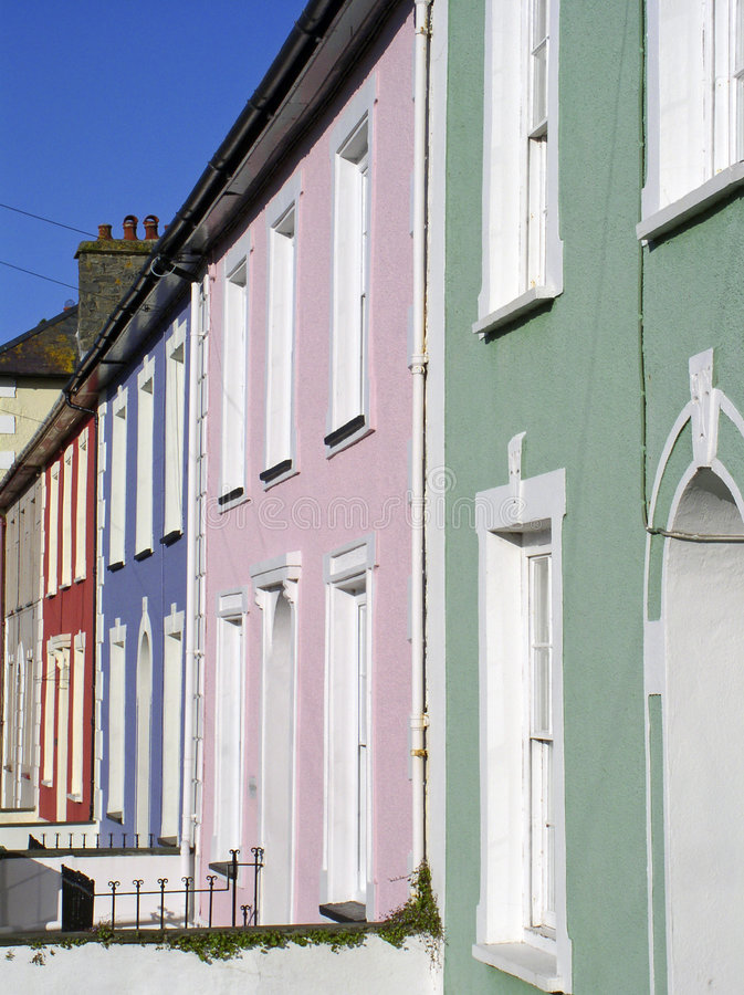Pastel coloured housefronts royalty free stock photography