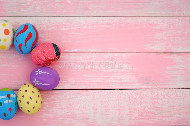 Pastel Hand painted Easter Eggs with pink background stock images